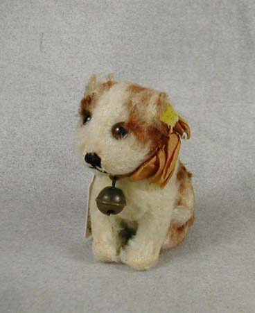 1949-58 3310 Steiff Molly Junghund (hound puppy) has button, cloth tag & original ribbon but no chest tag. $125.00